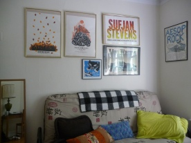 leland concert posters and futon