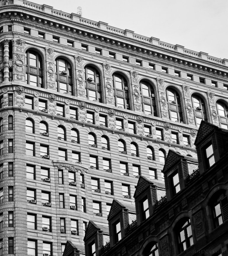 black and white tall buildings by john cobb
