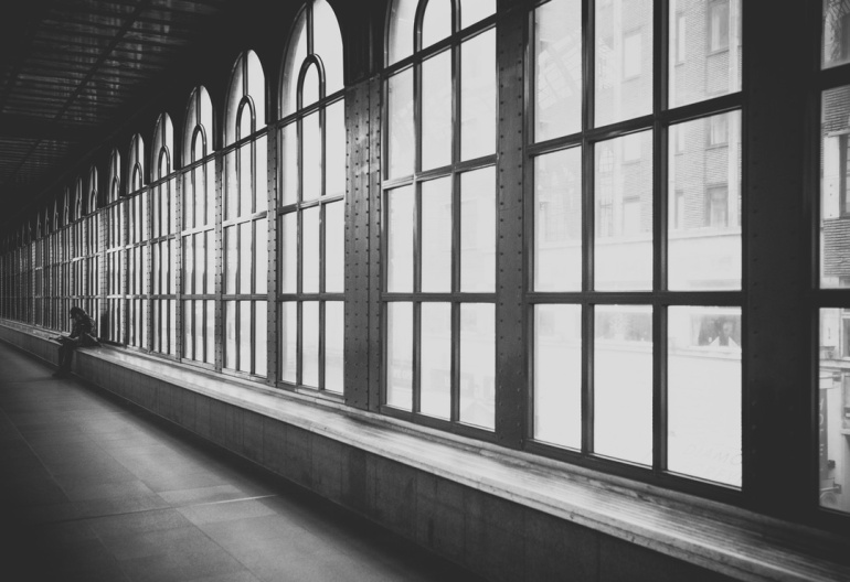 black and white windows hallway by padurariu alexandru unsplash