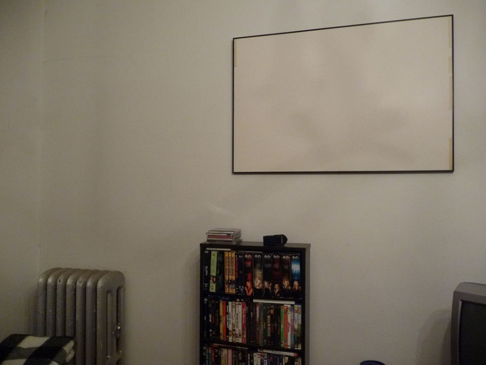 empty poster frame and DVDs
